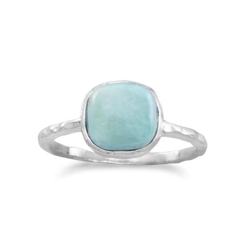 Stackable textured sterling silver ring set with a cushion cut turquoise
