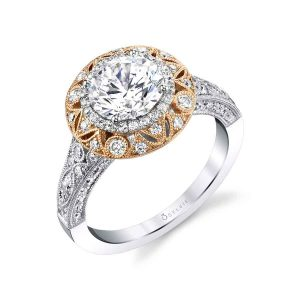 White gold diamond vintage style engagement ring with rose gold accents and a halo setting from the Sylvie Collection