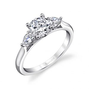 White gold diamond engagement ring from the Sylvie Collection featuring a large round diamond with a pear shaped diamond on either side