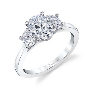 A white gold three-stone diamond engagement ring from the Sylvie Collection featuring three oval shaped diamonds