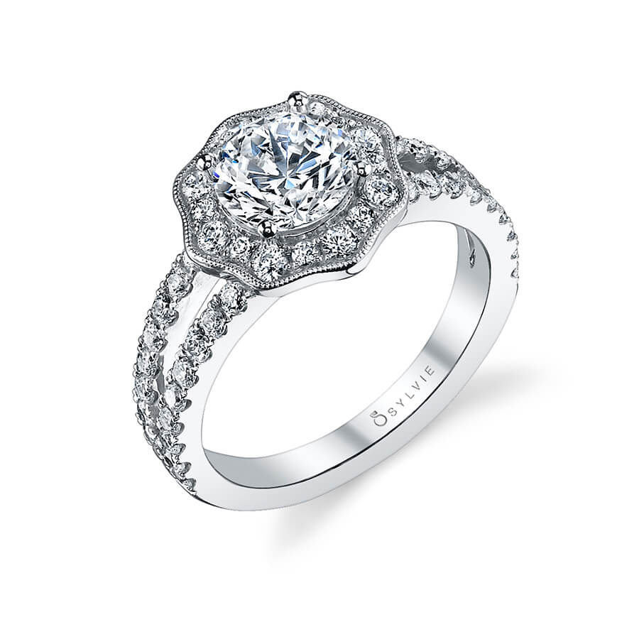 A white gold diamond engagement ring from the Sylvie Collection featuring a milgrain accented halo around the center diamond