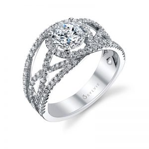 A white gold diamond engagement ring from the Sylvie Collection featuring a prominent round diamond and an open weaving diamond pattern
