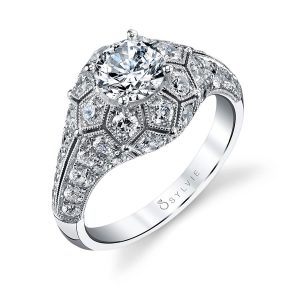 A diamond engagement ring from the Sylvie collection in white gold with geometric patterns surrounding a large center diamond