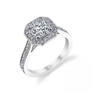 A white gold diamond engagement ring from the Sylvie Collection featuring milgrain accents and an octagon shaped halo around the center diamond
