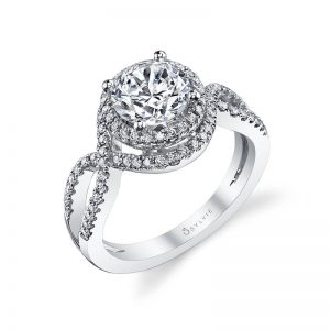 A white gold diamond engagement ring from the Sylvie Collection featuring a twisting diamond shank that wraps around a round diamond halo setting