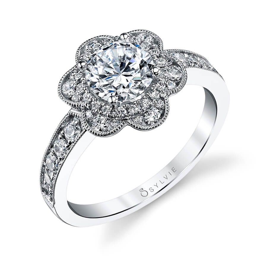 A white gold diamond engagement ring from the Sylvie Collection featuring a halo around the center stone with floral accents