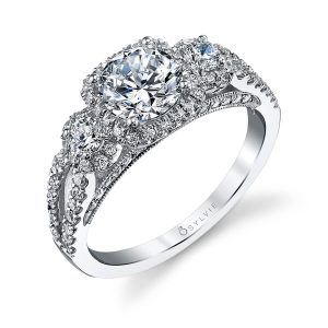 A white gold three stone diamond ring with halos from the Sylvie Collection