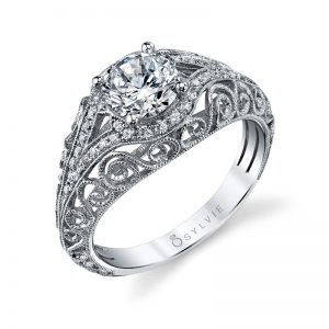 A white gold diamond engagement ring from the Sylvie Collection with sweeping curved designs
