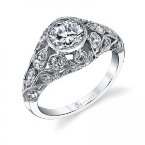 Vintage style white gold diamond engagement ring with a large center bezel set diamond from the Sylvie Collection