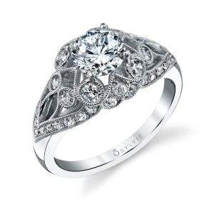 A white gold diamonds engagement ring from the Sylvie Collection featuring diamonds among the sweeping designs
