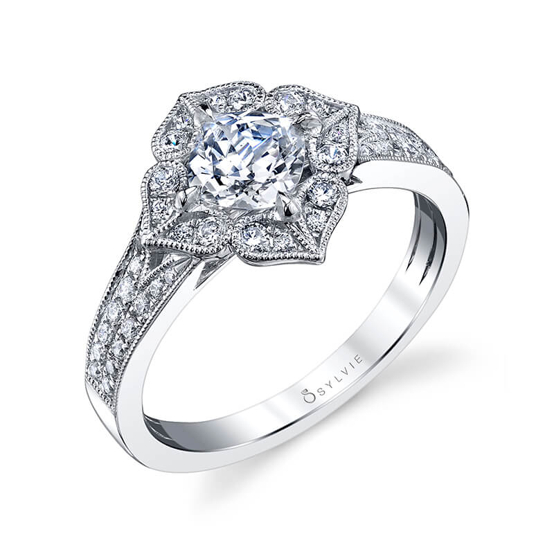A white gold diamond engagement ring from the Sylvie Collection featuring a floral shaped halo with milgrain accents