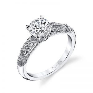 A white gold diamond engagement ring from the Sylvie Collection featuring floral motifs with diamond accents