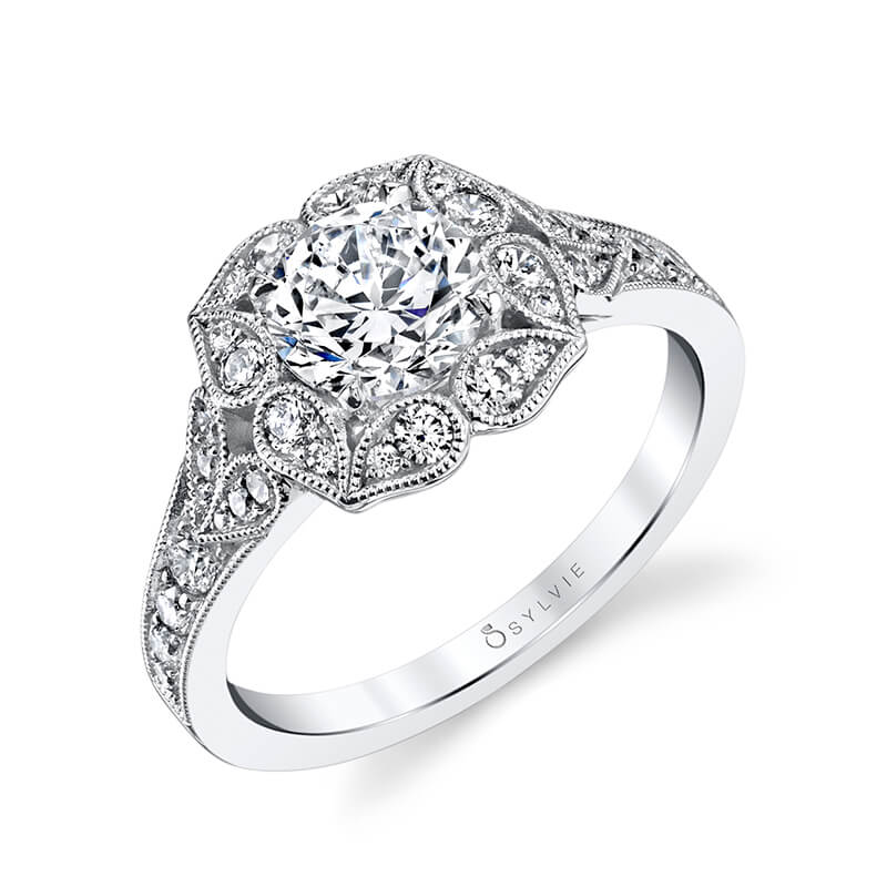 A white gold diamond engagement ring featuring a floral halo design