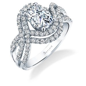 A white gold diamond engagement ring from the Sylvie Collection featuring two sets of parallel rows of diamonds and an oval cut diamond in the center
