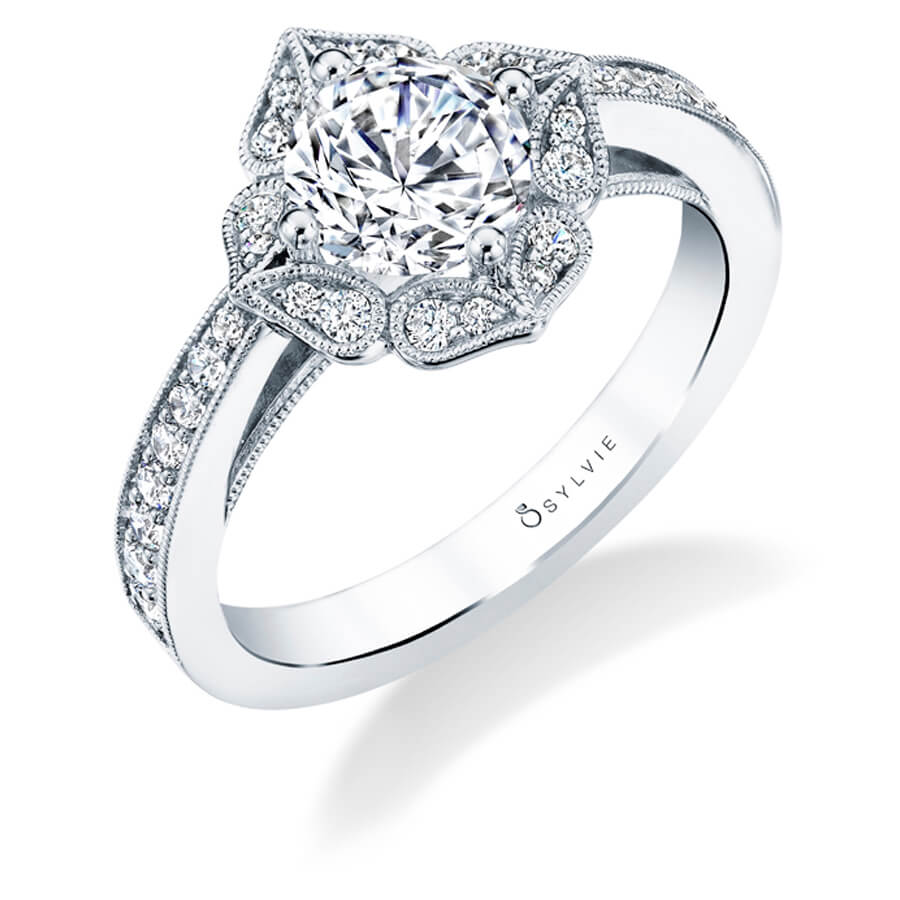 A white gold diamond engagement ring from the Sylvie Collection featuring petal shapes around a center diamond