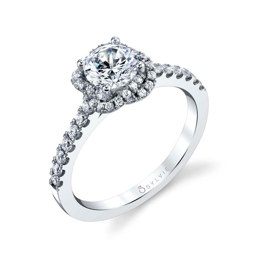 A white gold diamond engagement ring from the Sylvie Collection featuring a braided halo around the center stone