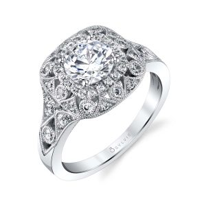 A vintage themed white gold engagement ring with diamonds from the Sylvie Collection