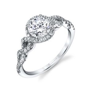 A white gold diamond engagement ring from the Sylvie Collection featuring a large center diamond with a twisting diamond shank