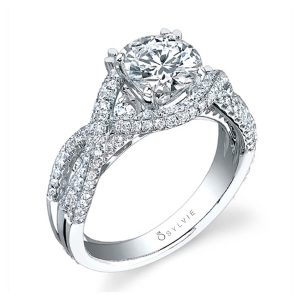 A white gold diamond engagement ring from the Sylvie Collection featuring a large round diamond inside a swirling diamond mounting