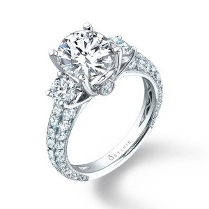 White gold three-stone diamond engagement ring with peek-a-boo diamonds from the Sylvie Collection