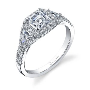 White gold diamond engagement ring from the Sylvie Collection featuring a halo around a central princess cut and two triangle cut diamonds
