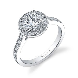 A white gold diamond engagement ring from the Sylvie Collection featuring a round diamond encircled by a halo setting