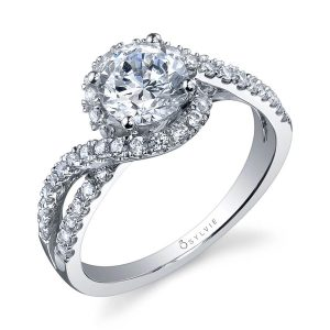 A white gold diamond engagement ring from the Sylvie Collection featuring a twisting halo mounting around a round diamond