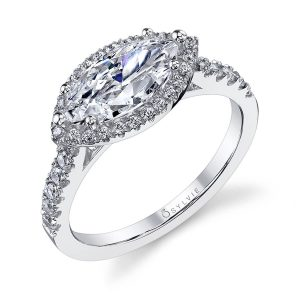 A white gold diamond engagement ring from the Sylvie Collection featuring a marquise cut diamond set lengthwise with a halo embracing it