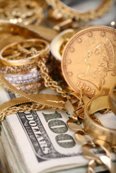 Gold coins and jewelry with $100 bills