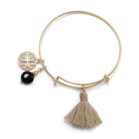Gold tone fashion bangle with tan tassel and onyx bead charm